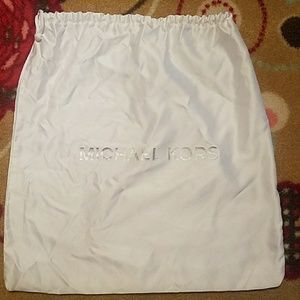 Silky white Michael Kors bag.